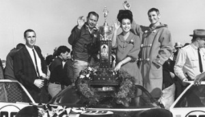 DAYTONA BEACH, FL - FEBRUARY 6, 1966:  Drivers Lloyd Ruby and Ken Miles enjoy victory lane following their win in the first 24 Hours of Daytona at Daytona International Speedway driving a Ford Mk II for Shelby American Racing. The pair had teamed the year before to win the Daytona Continental 2000 KM race. A month later, Ruby and Miles would combine to also win the 12 Hours of Sebring in Sebring, Florida. (Photo by ISC Images & Archives via Getty Images)